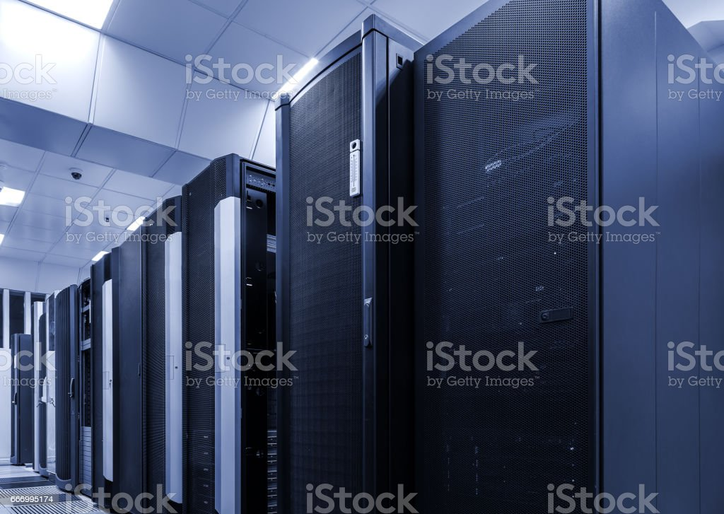 room with rows of server hardware in data center stock photo