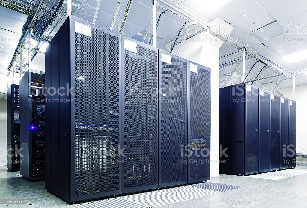 room with rows of server hardware in the data center stock photo