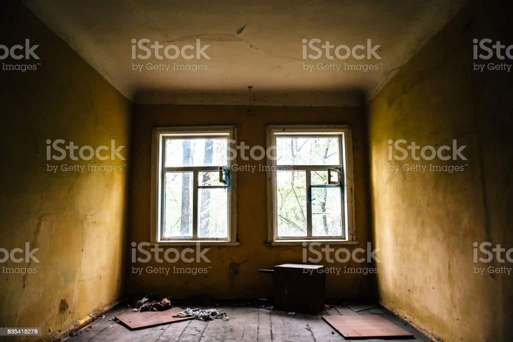 Room with two windows in abandoned ruined house stock photo