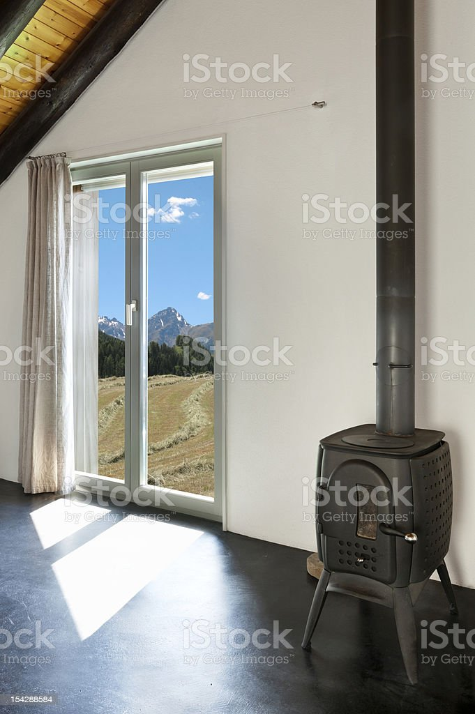 room with wood stove royalty-free stock photo