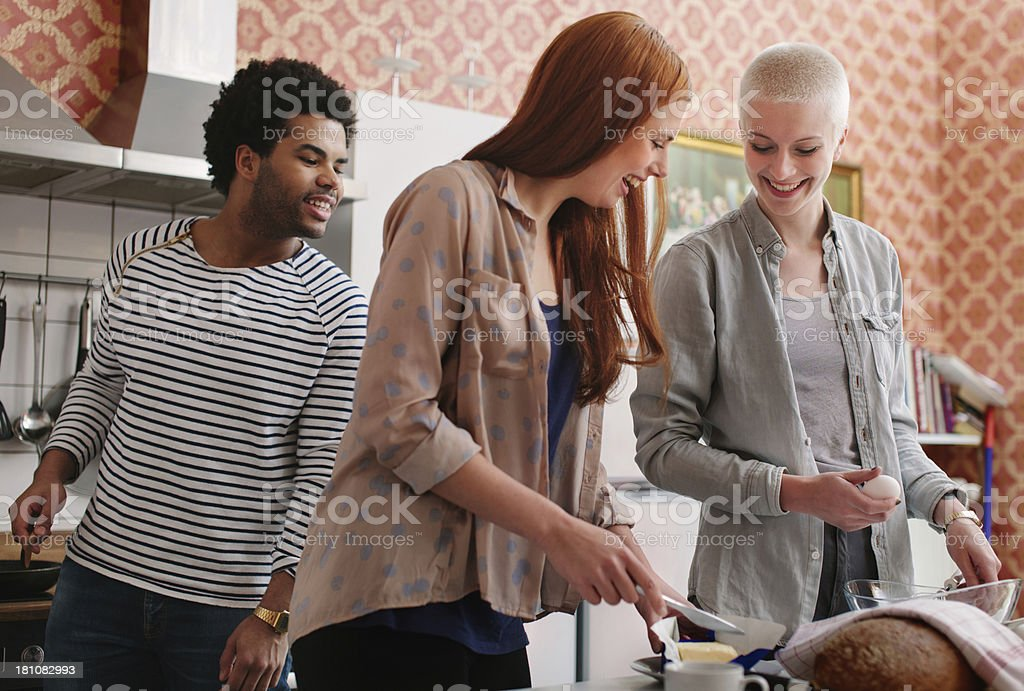 Roomates preparing Breakfast together stock photo