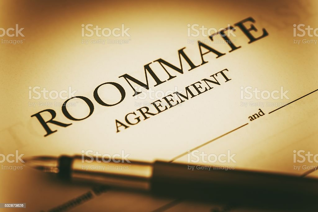 Roommate Agreement Signing stock photo
