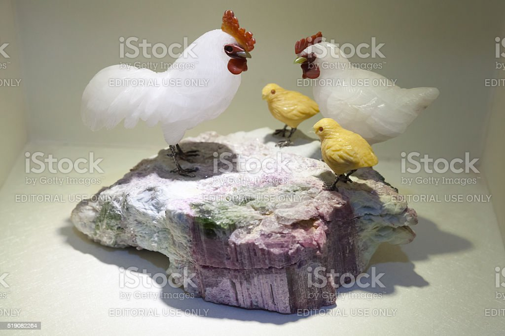 Rooster and chickens made of gemstone, China stock photo