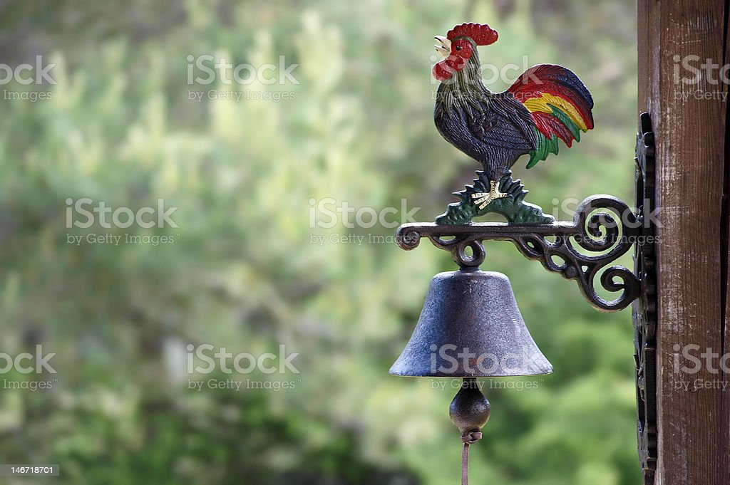 rooster on a bell stock photo