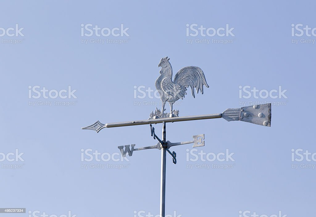 Rooster weather vane stock photo