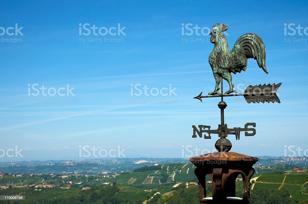 Rooster Weather Vane Pointing North stock photo
