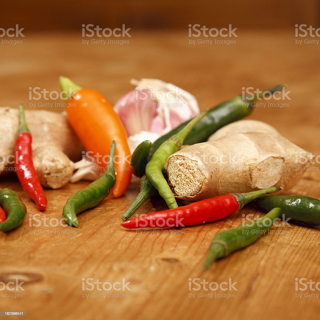 root ginger with thai chillis and garlic stock photo