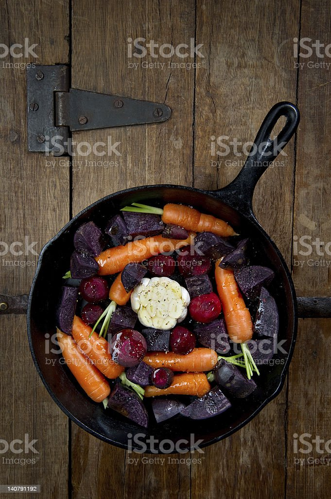 Root Vegetables in a Cast Iron Skillet stock photo