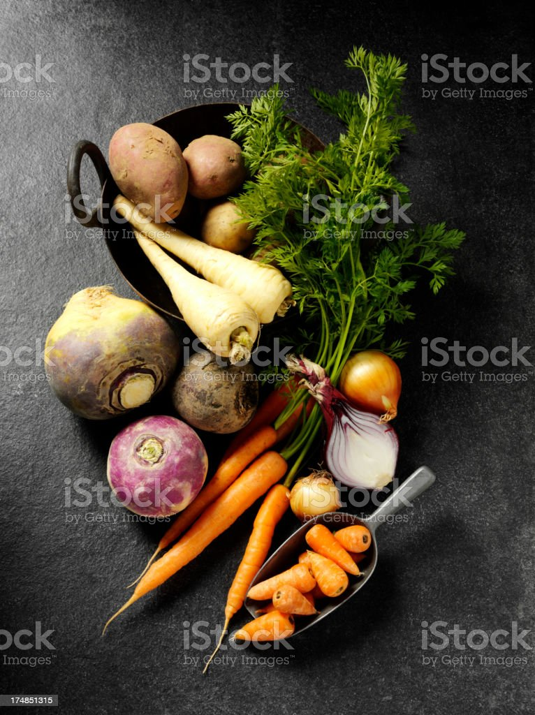 Root Vegetables on a Slate Background stock photo