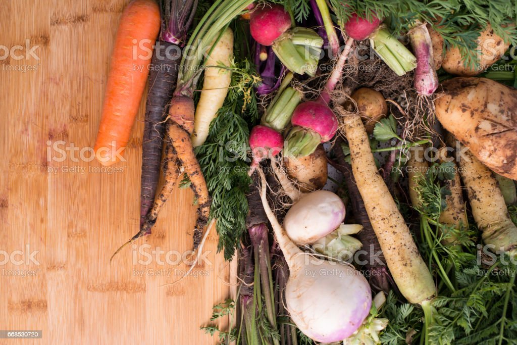 Root vegetables on chopped board. stock photo