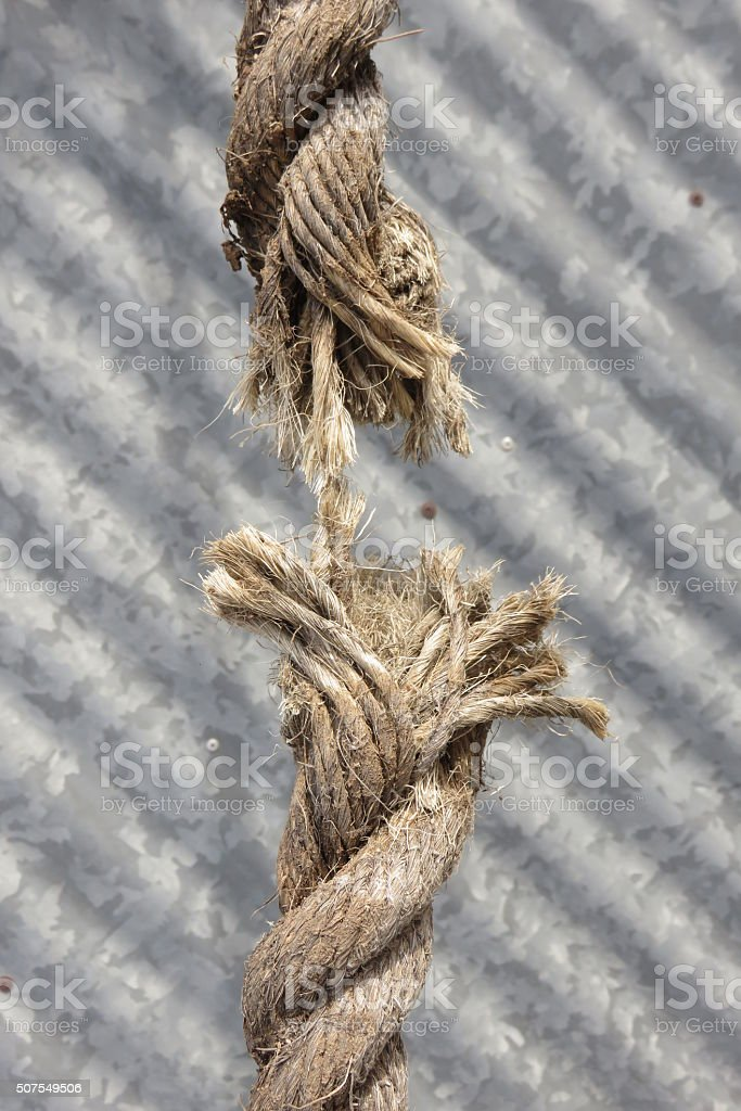 Rope about to break stock photo