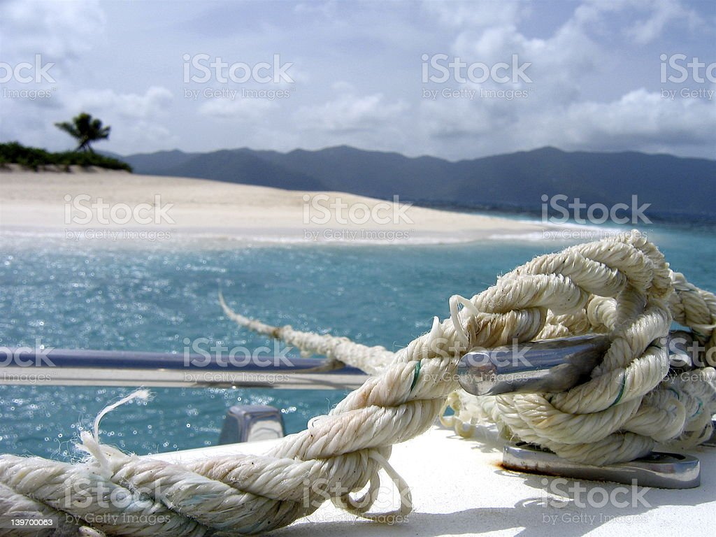 Rope anchored to Island royalty-free stock photo