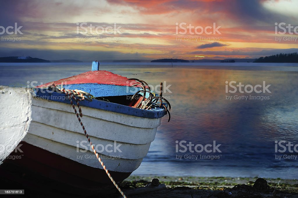 Rope and ancor in the bow/front of old fishing boat stock photo