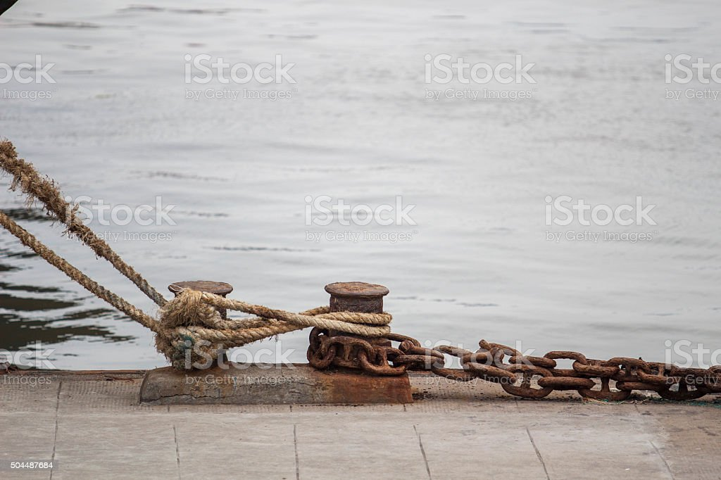 rope and bollards at waterside stock photo