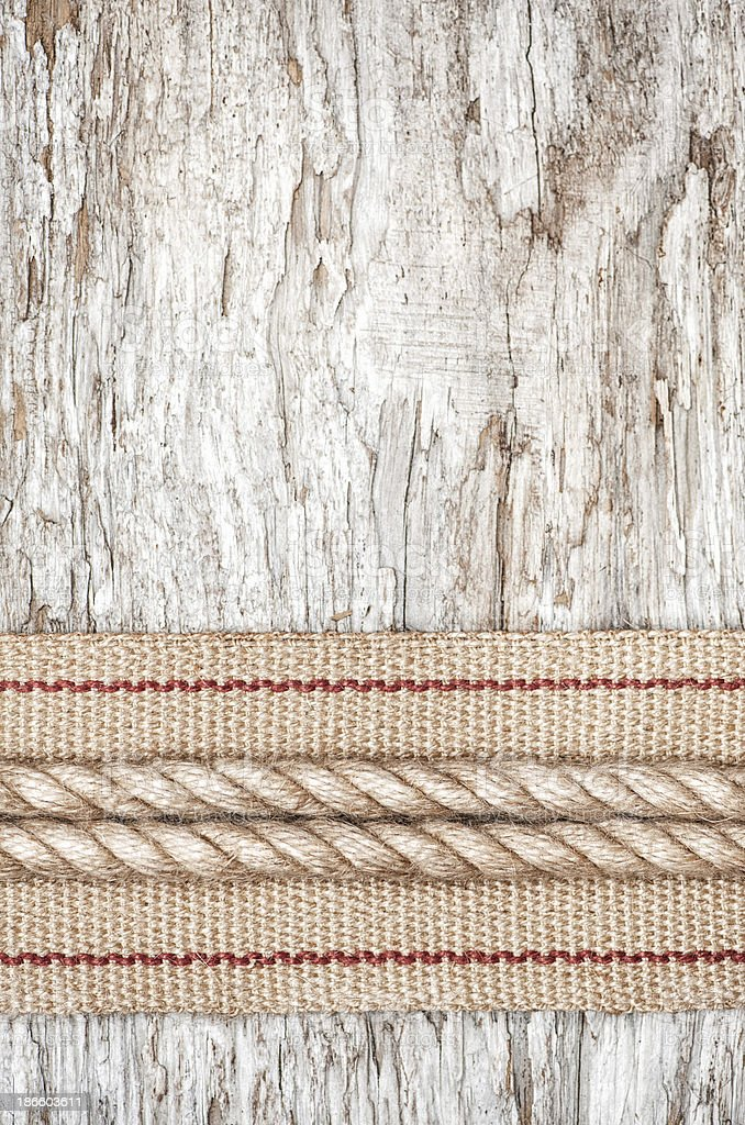 Rope and hardware ribbon on the old wood royalty-free stock photo