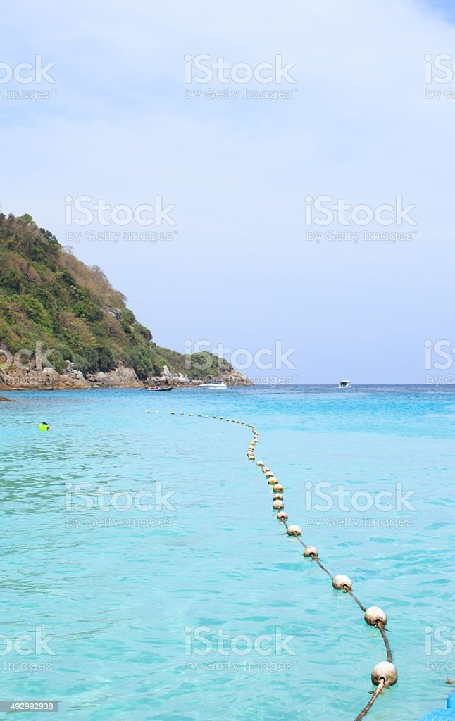 rope and sea buoy on sea wave and sky stock photo