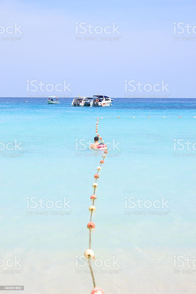 rope and sea buoy on sea wave to speed boat stock photo