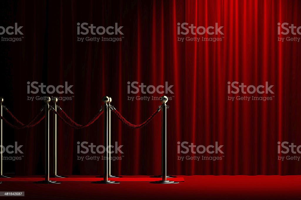 Rope barrier with red carpet and curtain stock photo