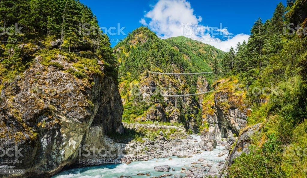 Rope bridges across mountain river canyon Everest trail Himalayas Nepal stock photo