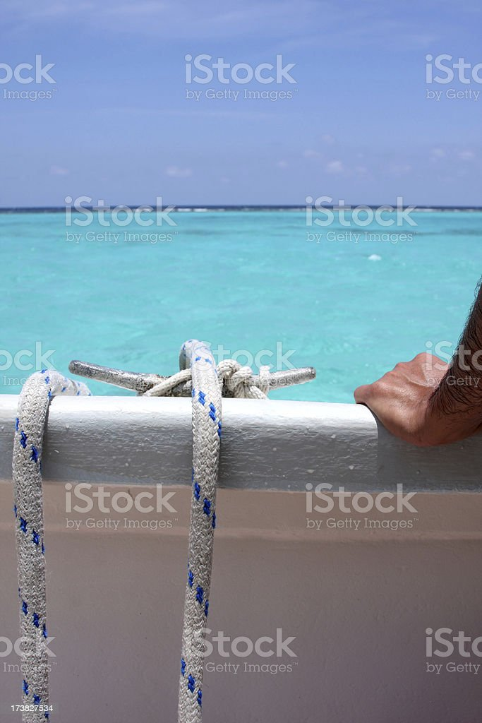 Rope cleat and a hand royalty-free stock photo