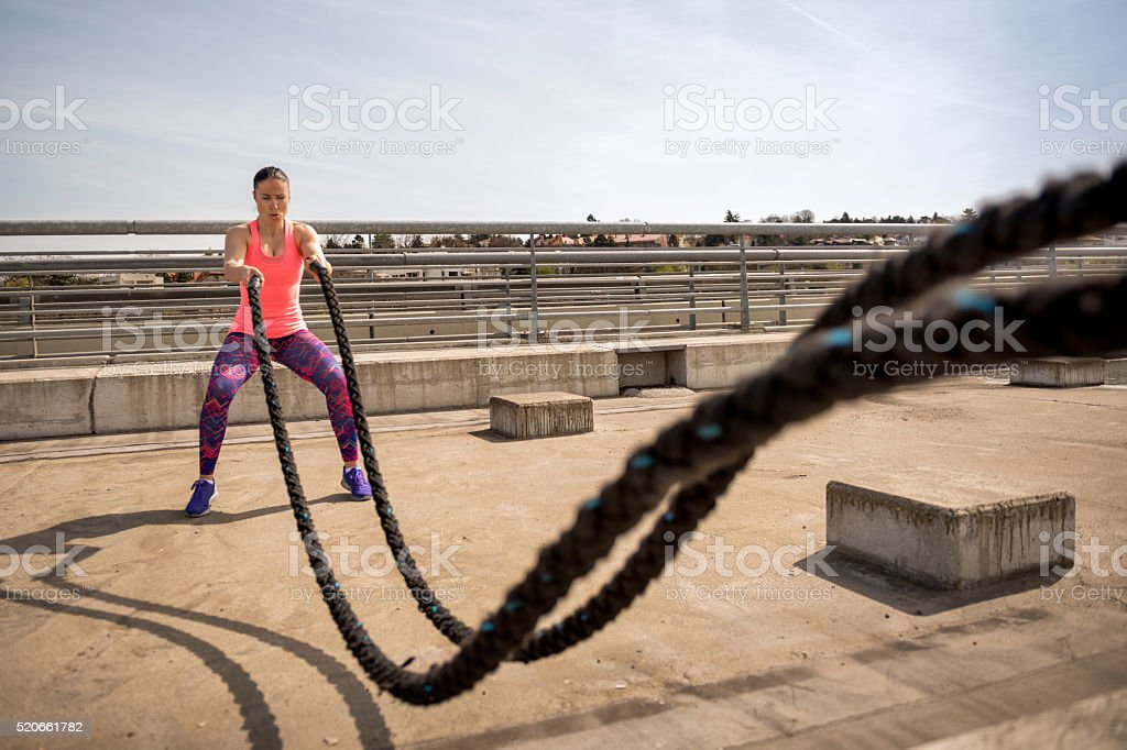 Rope exercise on the bridge stock photo