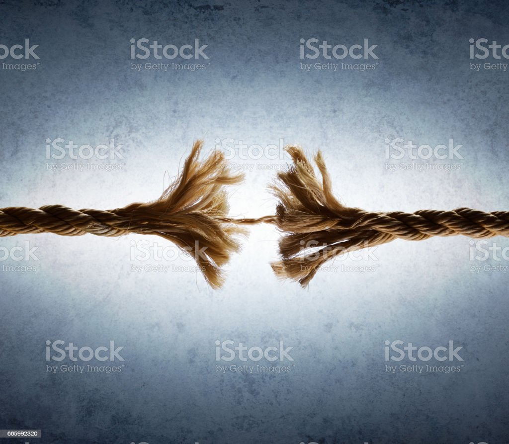 Rope Frayed In Tension - Risk Of Breaking stock photo