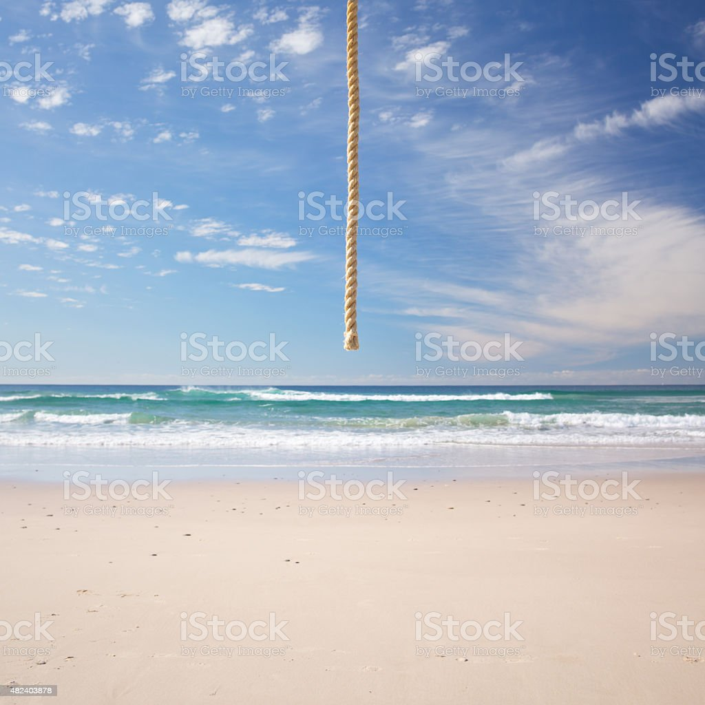 Rope Hanging From Sky at Beach stock photo