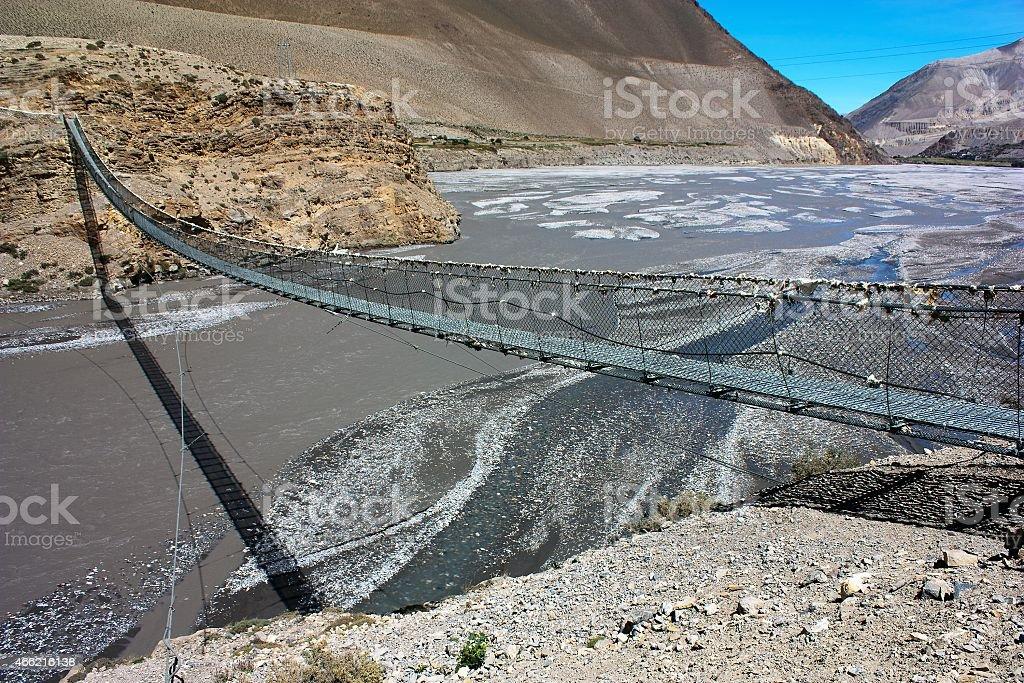 rope hanging suspension bridge above Kali Gandaki stock photo