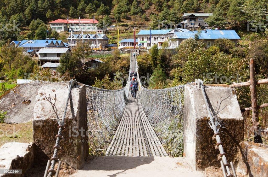 rope hunging suspension bridge - nepal stock photo