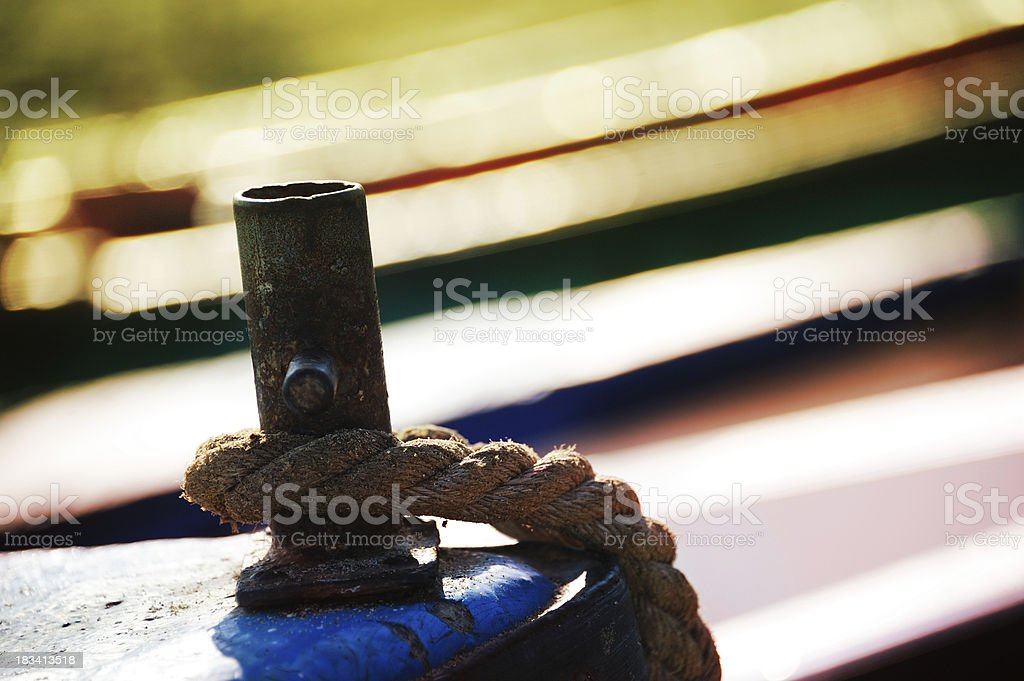 Rope in the bow/front of old fishing boat stock photo