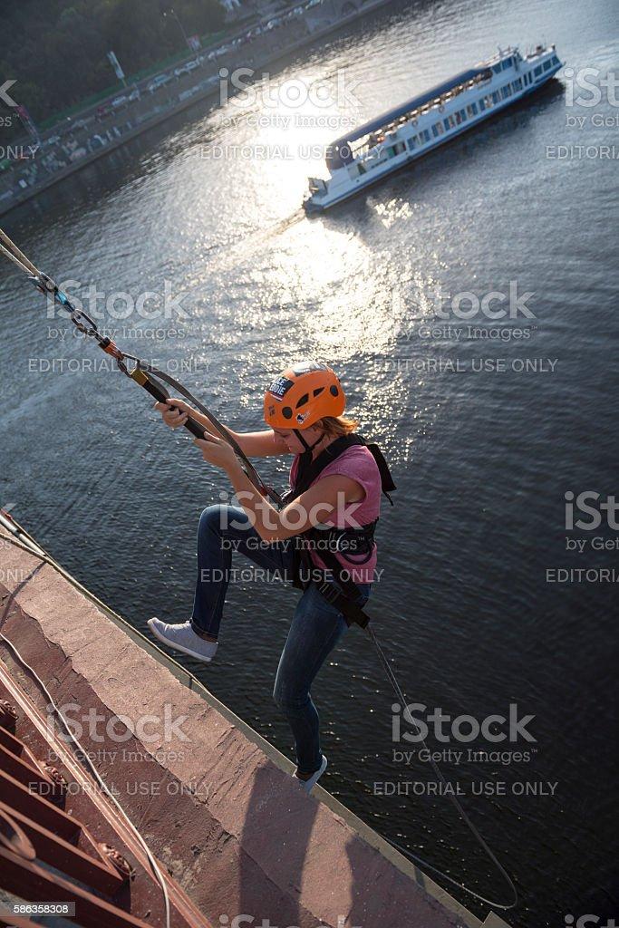 Rope jumping off Parkovy Pedestrian Bridge in Kiev, Ukraine stock photo