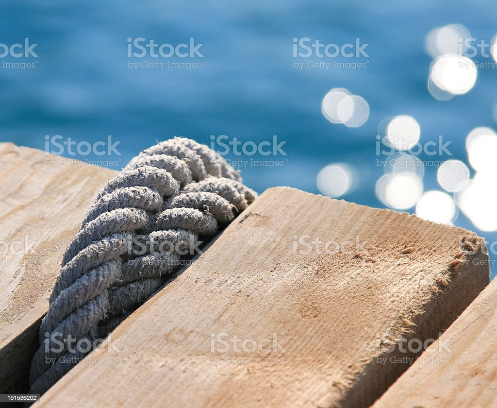 Rope knot on a mooring royalty-free stock photo