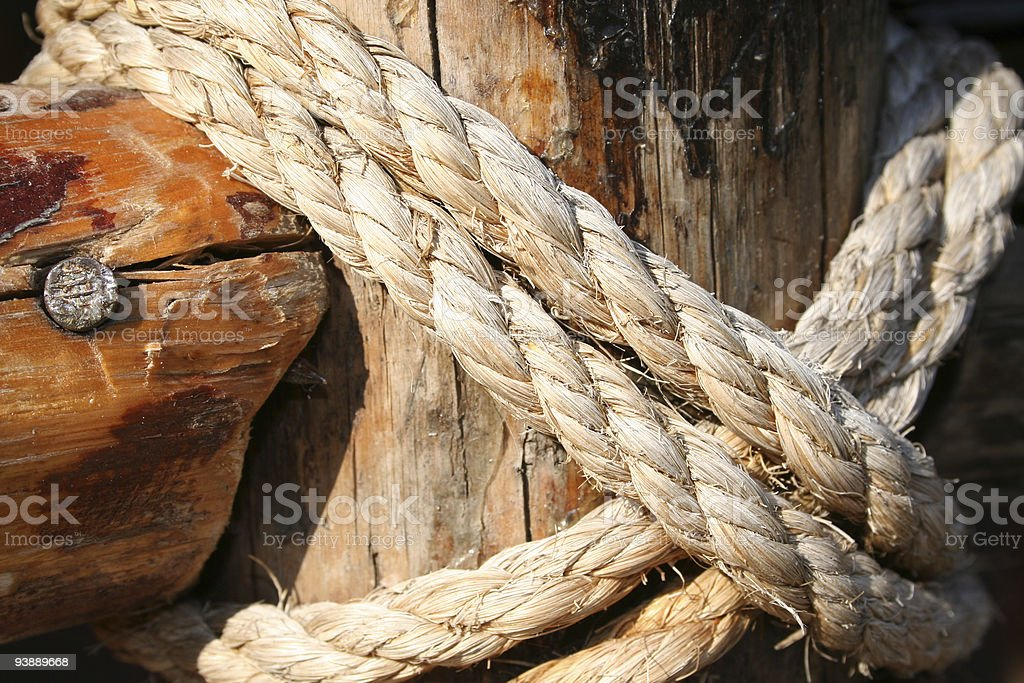 Rope, nail and wooden surface royalty-free stock photo