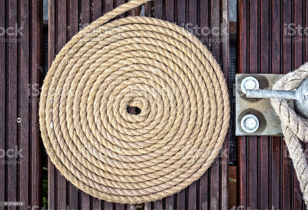 Rope of a sailboat is curled into circle stock photo