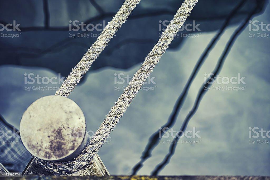 rope on a bollard stock photo