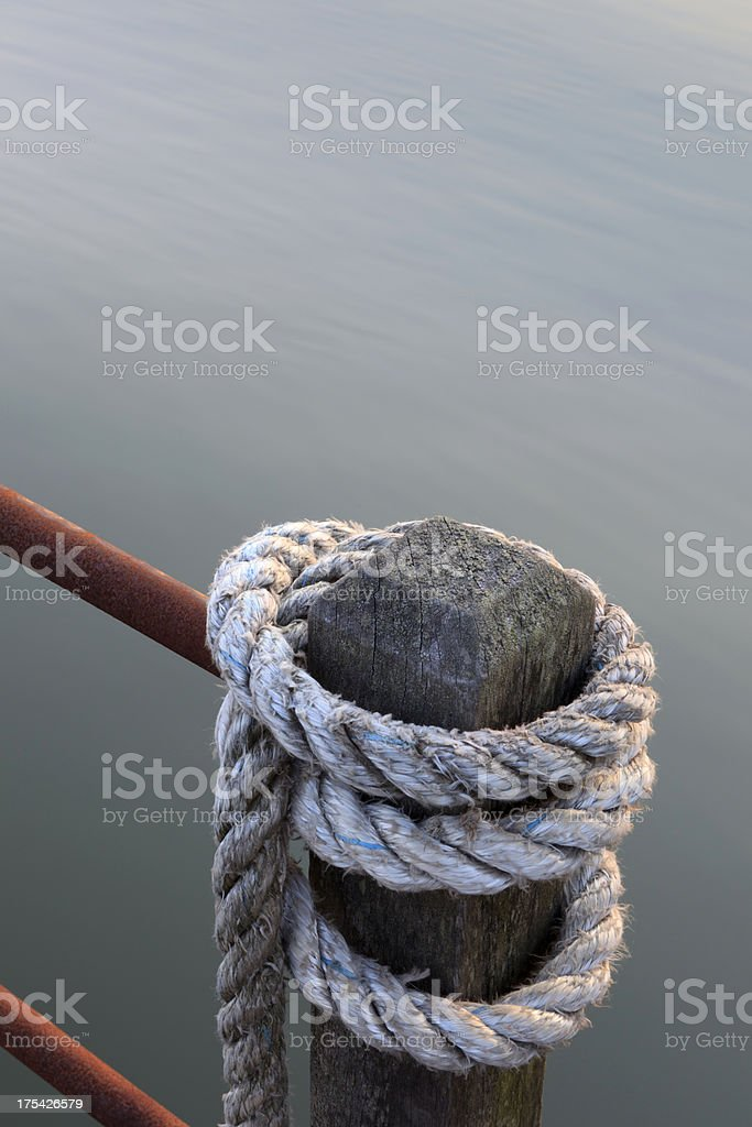 rope on a mooring post stock photo