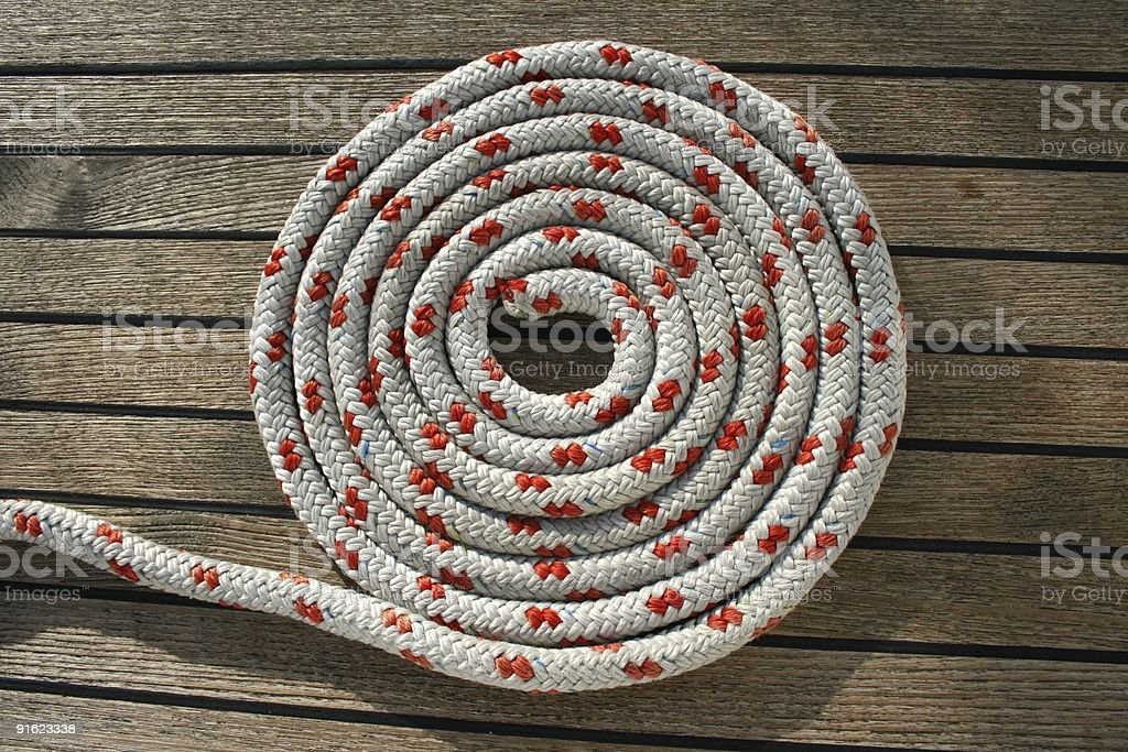 Rope on a teak deck royalty-free stock photo