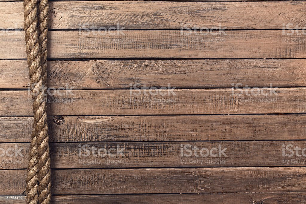 Rope on old wooden board vertical stock photo
