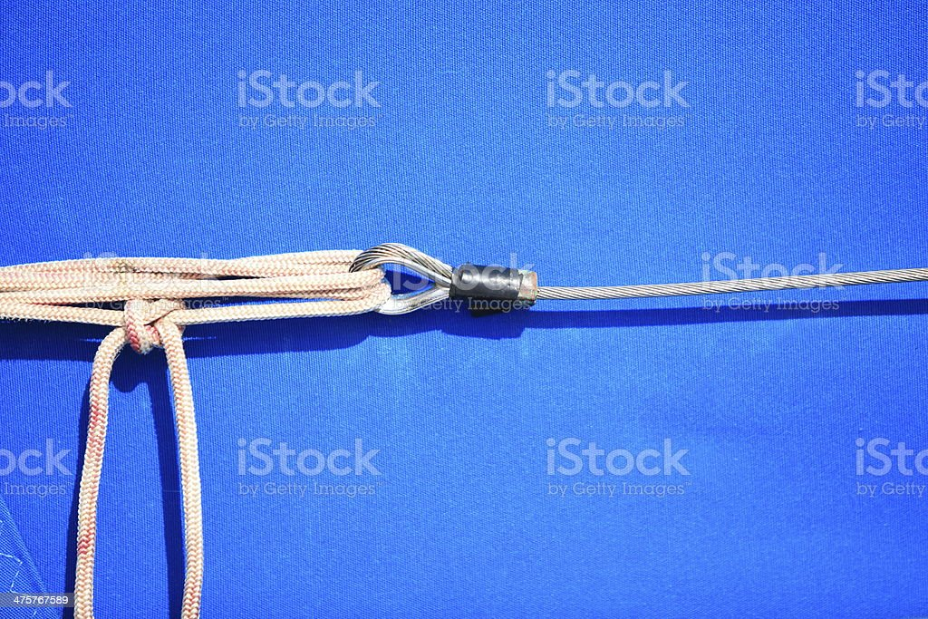 rope on sailing boat rigging blue background royalty-free stock photo