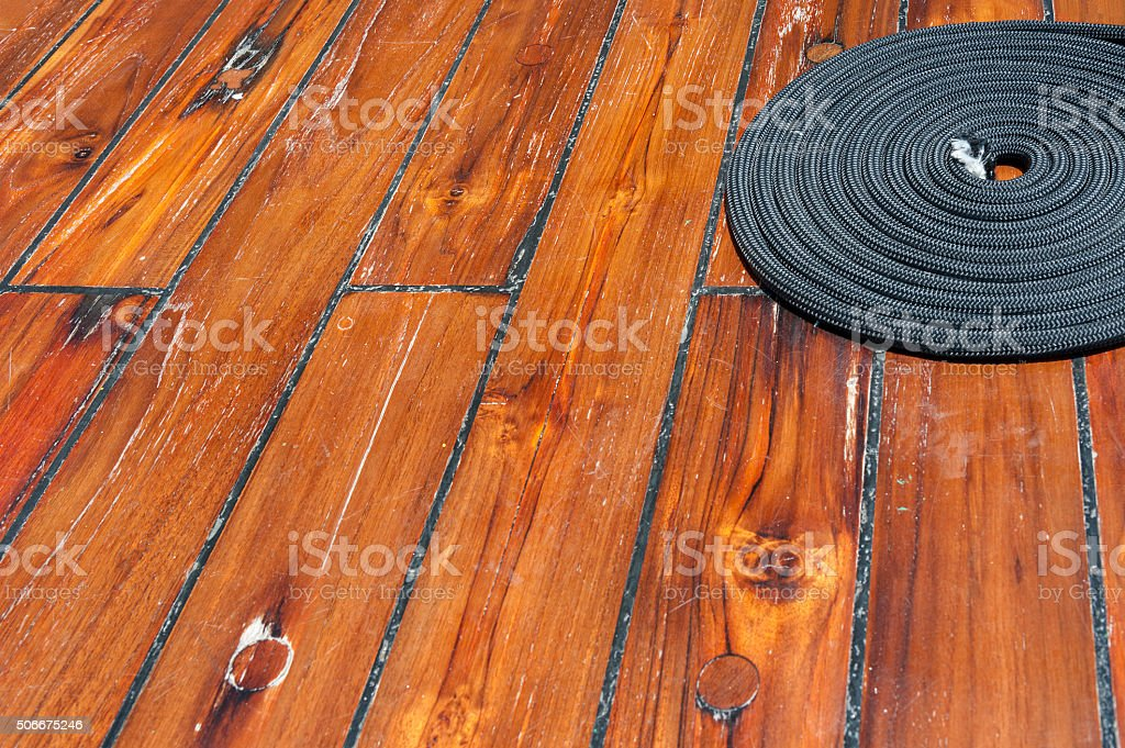 Rope on wooden deck stock photo