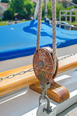 Rope pulley or tackle on a sailboat.