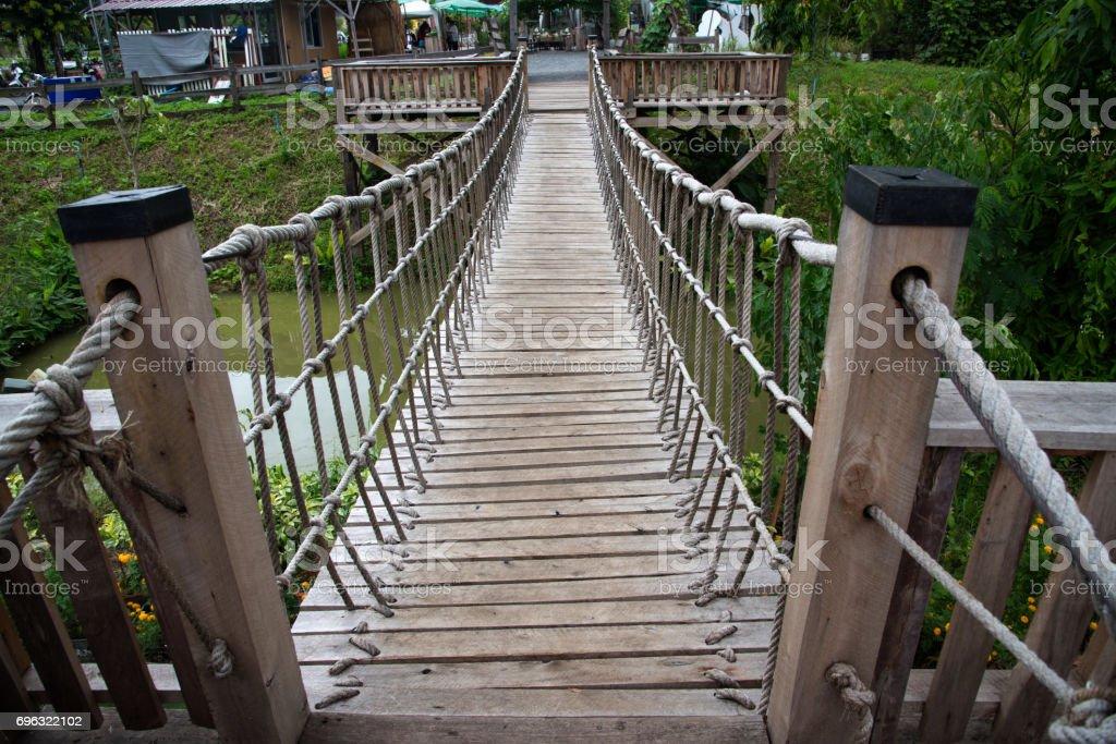 Rope suspension wooden bridge stock photo