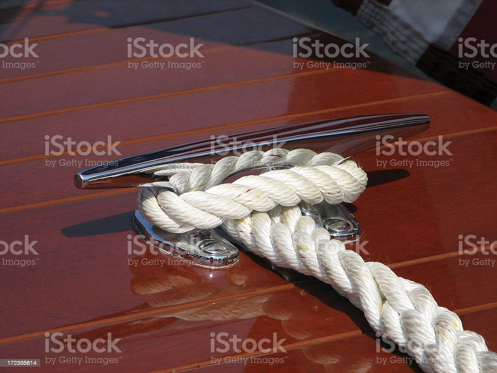 Rope Tied Around Clete on Antique Wood Boat royalty-free stock photo