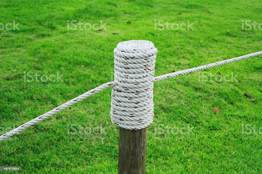 rope tied to a pole stock photo
