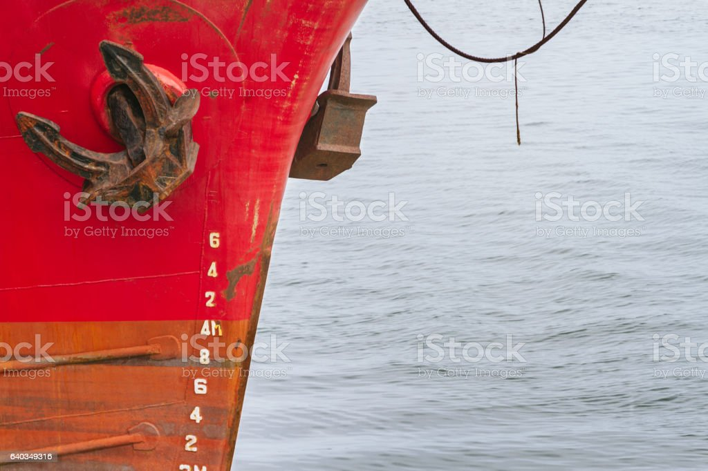 Rope tied to the hull of a boat moored stock photo