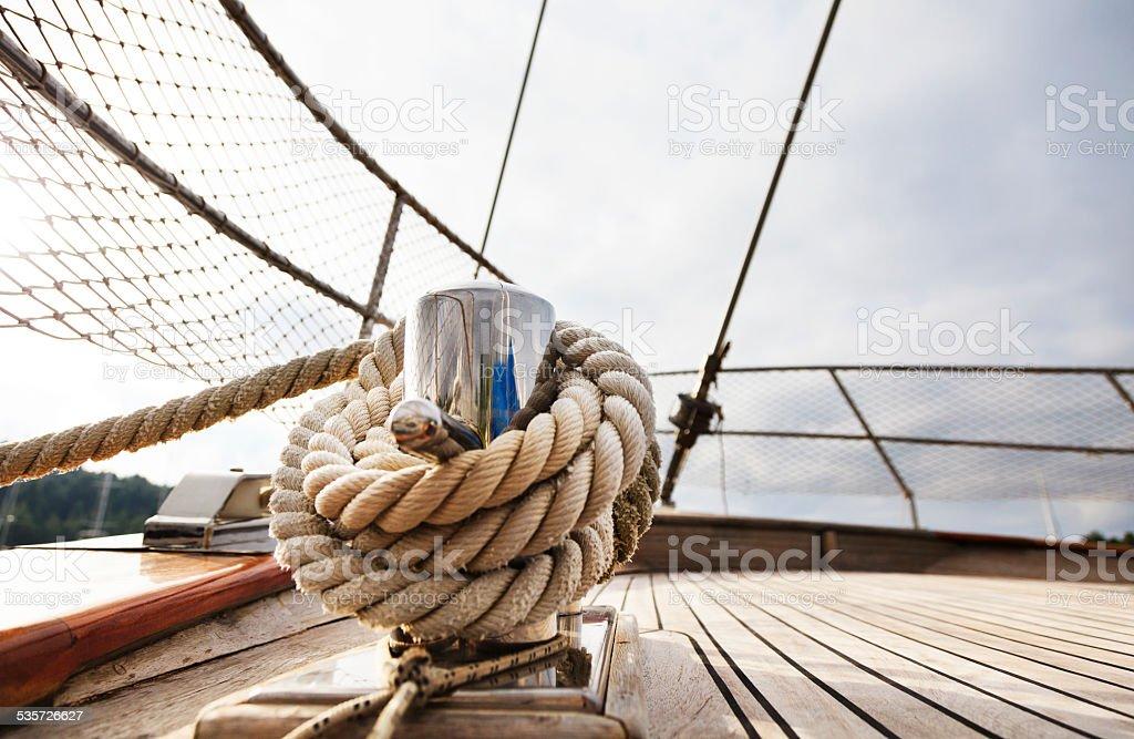 Rope tighten on Cleat. Hawser. Sailing Yacht. Hawser. Deck. stock photo