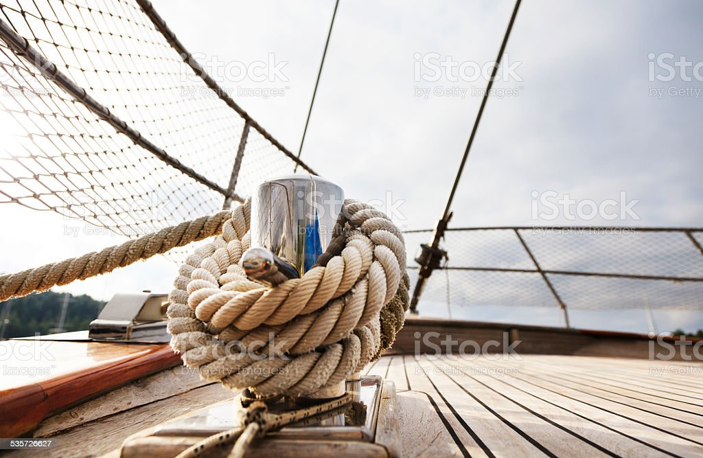Rope tighten on Cleat. Hawser. Sailing Yacht. Hawser. Deck. stock photo