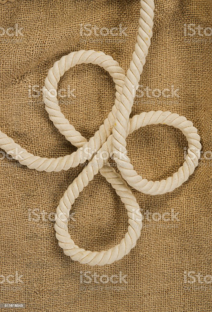 rope with a loops on a background of sackcloth stock photo