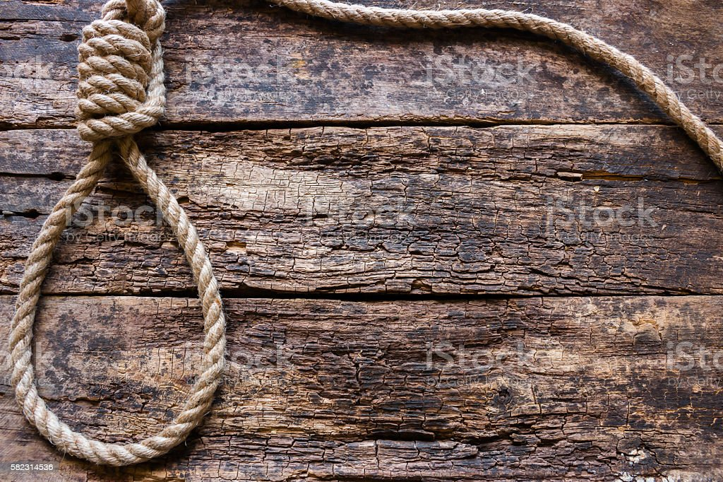 rope with a slipknot on the wooden background stock photo
