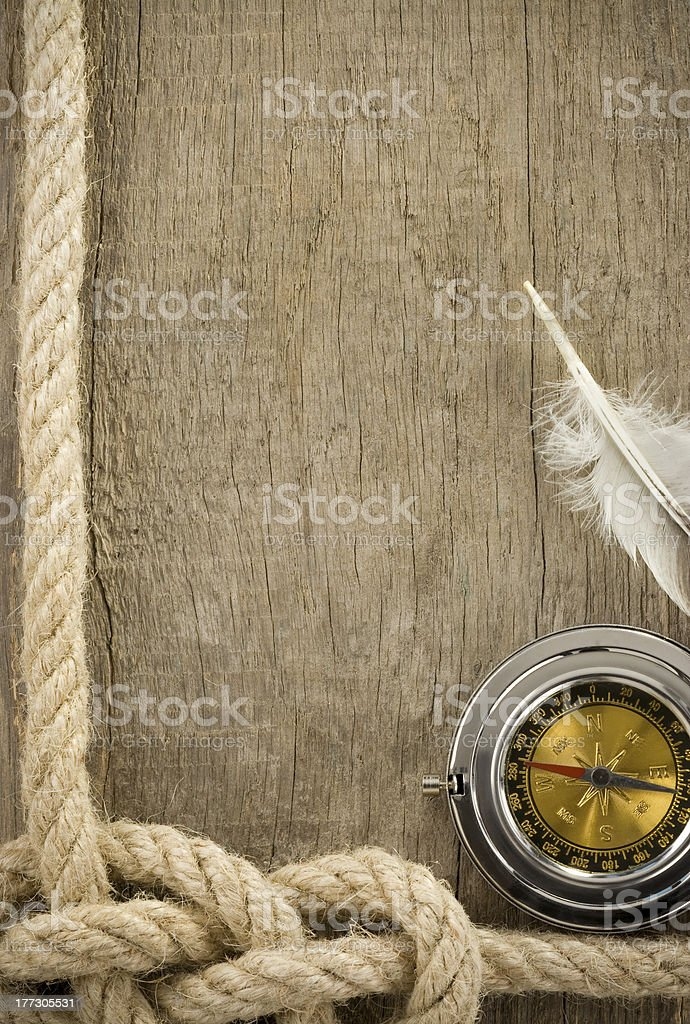 ropes and sea compass on wood royalty-free stock photo